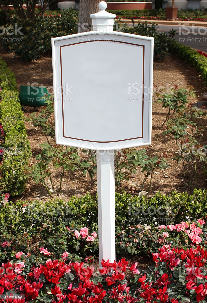 Blank Sign In Flower Bed royalty-free stock photo