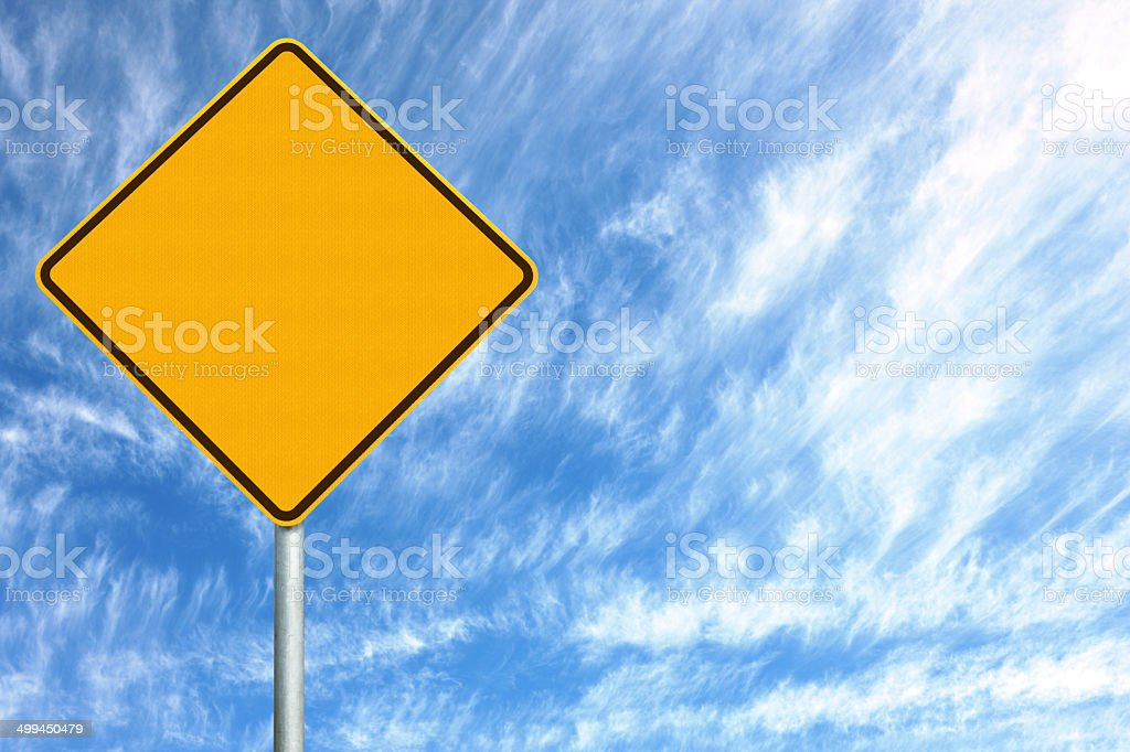 Blank Sign on a Cloudy Day stock photo