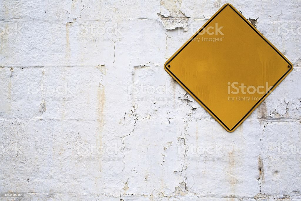 Blank sign on an old grungy wall royalty-free stock photo
