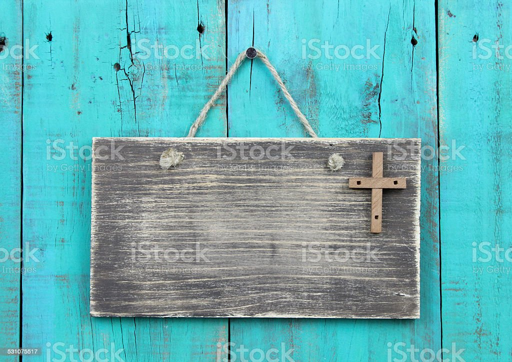 Blank sign with wood cross hanging on shabby wooden background stock photo