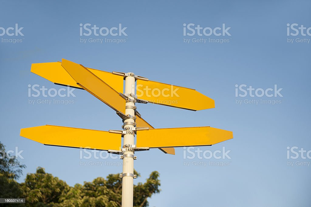 Blank signpost with six yellow pointers. royalty-free stock photo