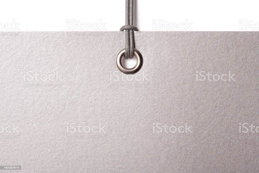 Blank silver card label hanging from cord stock photo
