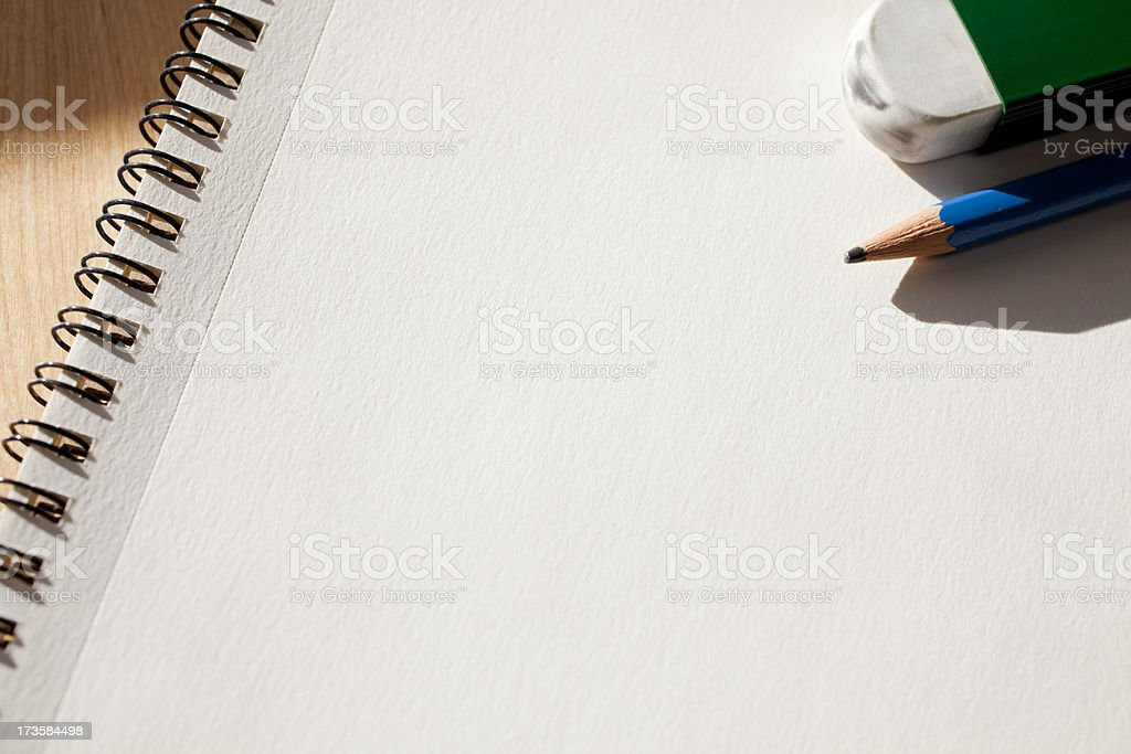 Blank Sketch Pad with Pencil and Eraser royalty-free stock photo