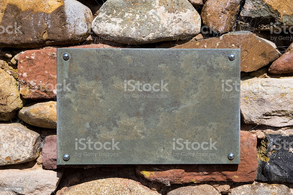 Blank Slate Sign on Stone Wall royalty-free stock photo