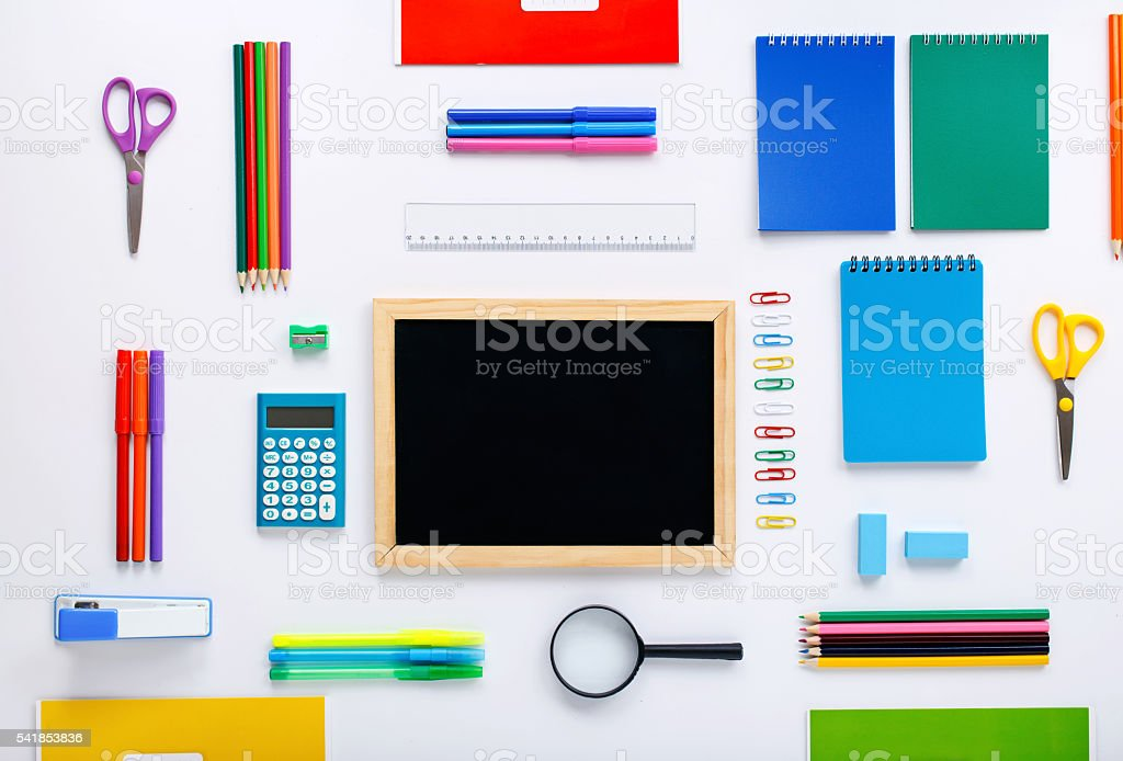 blank small chalkboard with group of school supplies stock photo