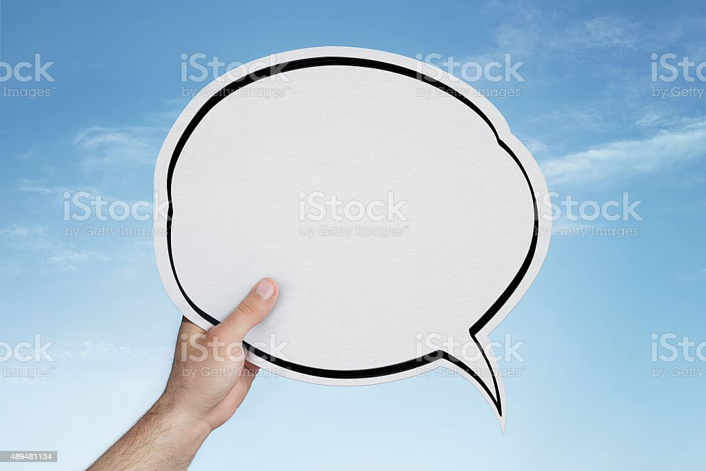 Blank speech bubble in hand stock photo