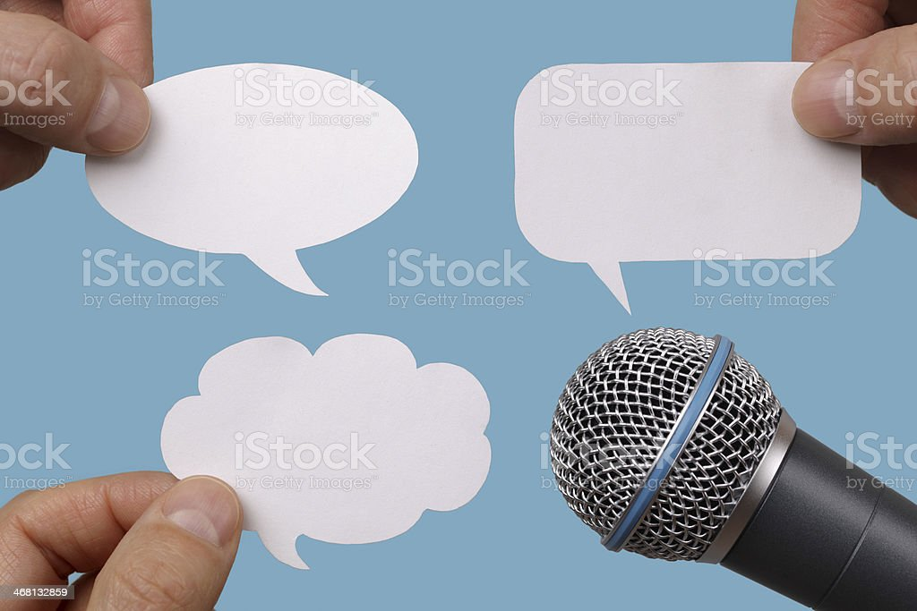 Blank speech bubbles with microphone stock photo