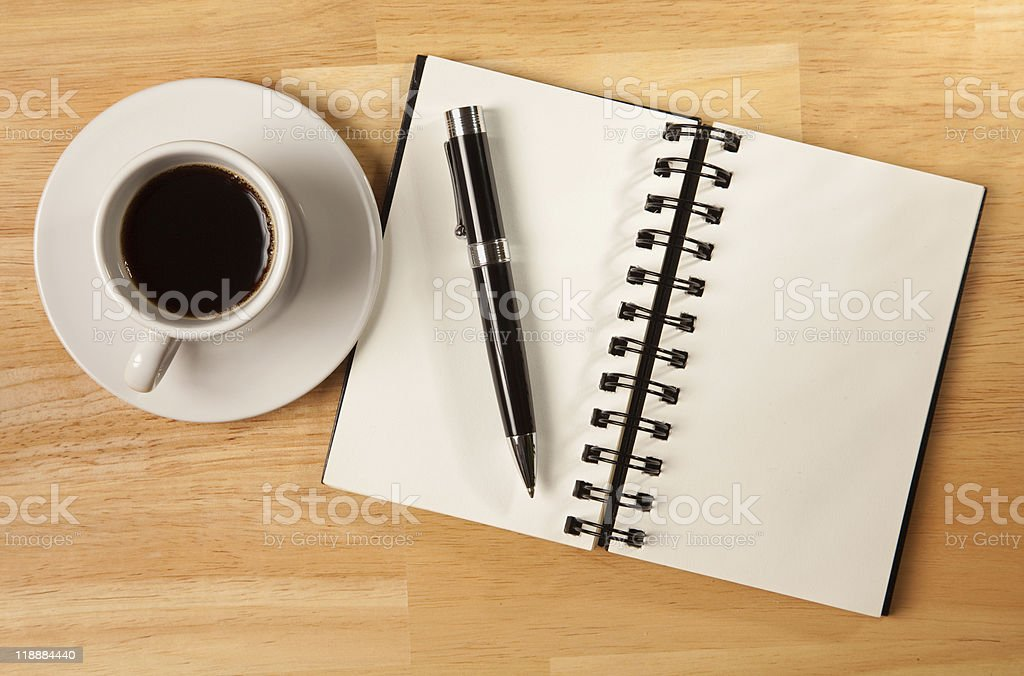 Blank Spiral Note Pad, Cup and Pen on Wood royalty-free stock photo