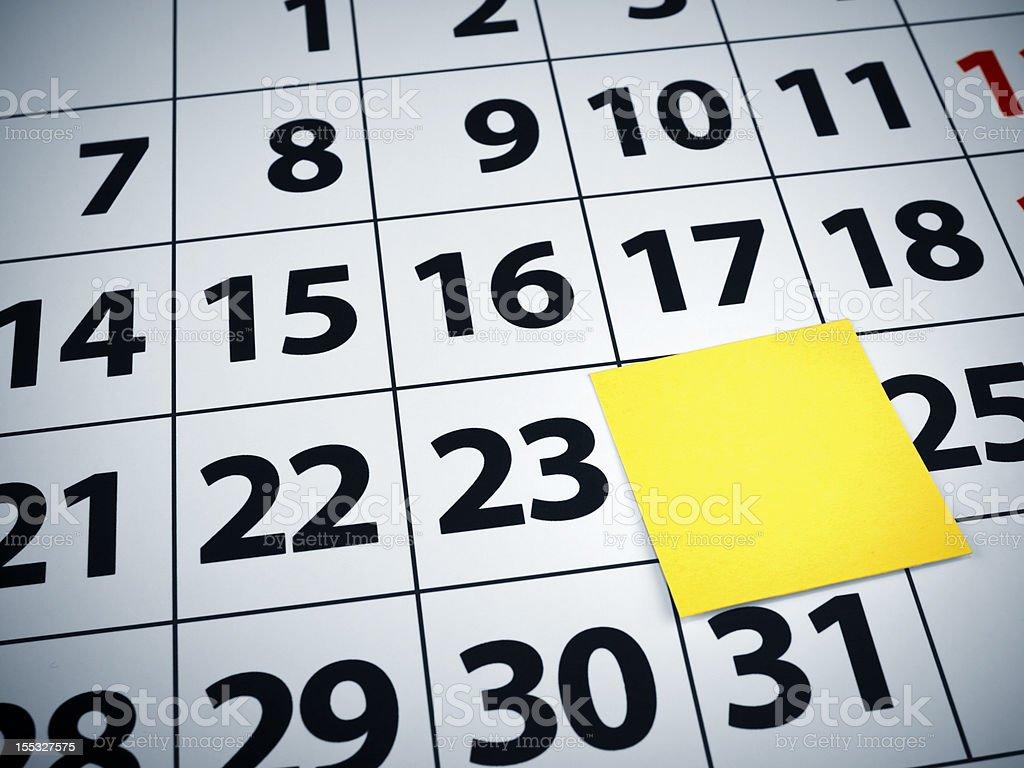 Blank sticky note on a calendar royalty-free stock photo