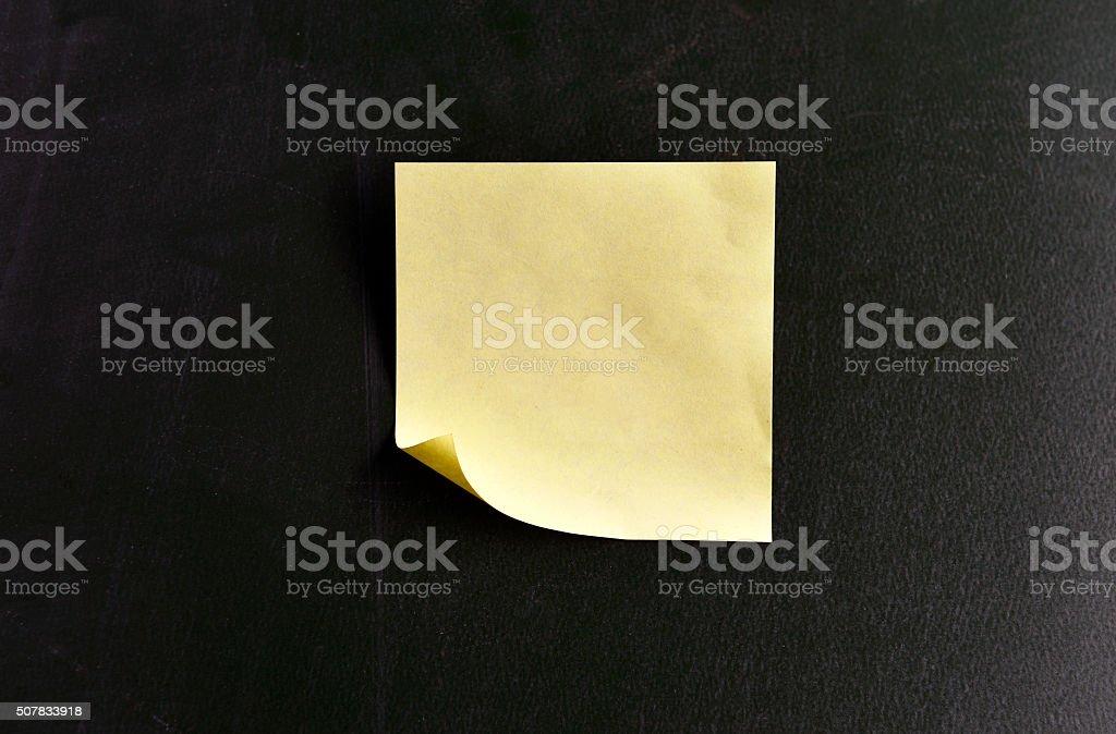Blank Sticky Note on Blackboard stock photo