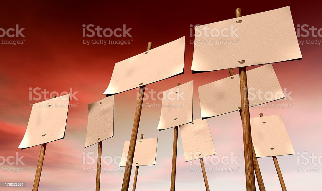 Blank Strikers Picket Plackards And Red Sky royalty-free stock photo