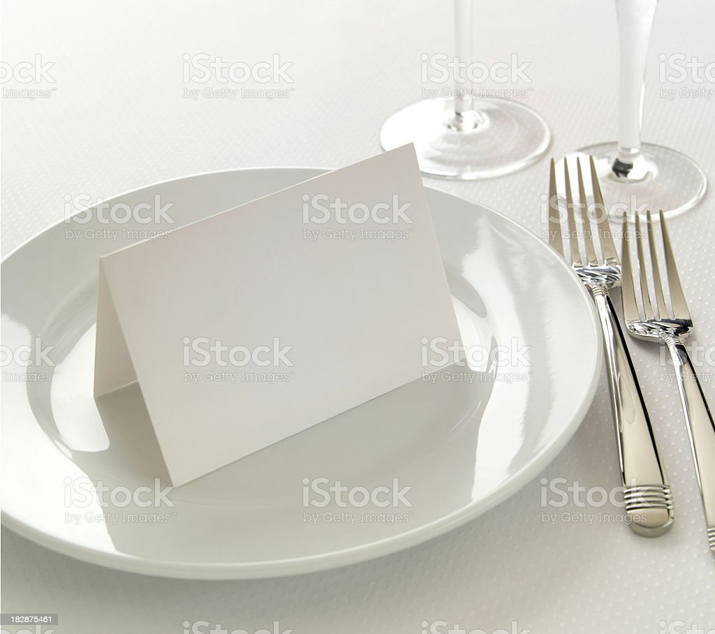 Blank tableseating place card white-on-white place setting stock photo