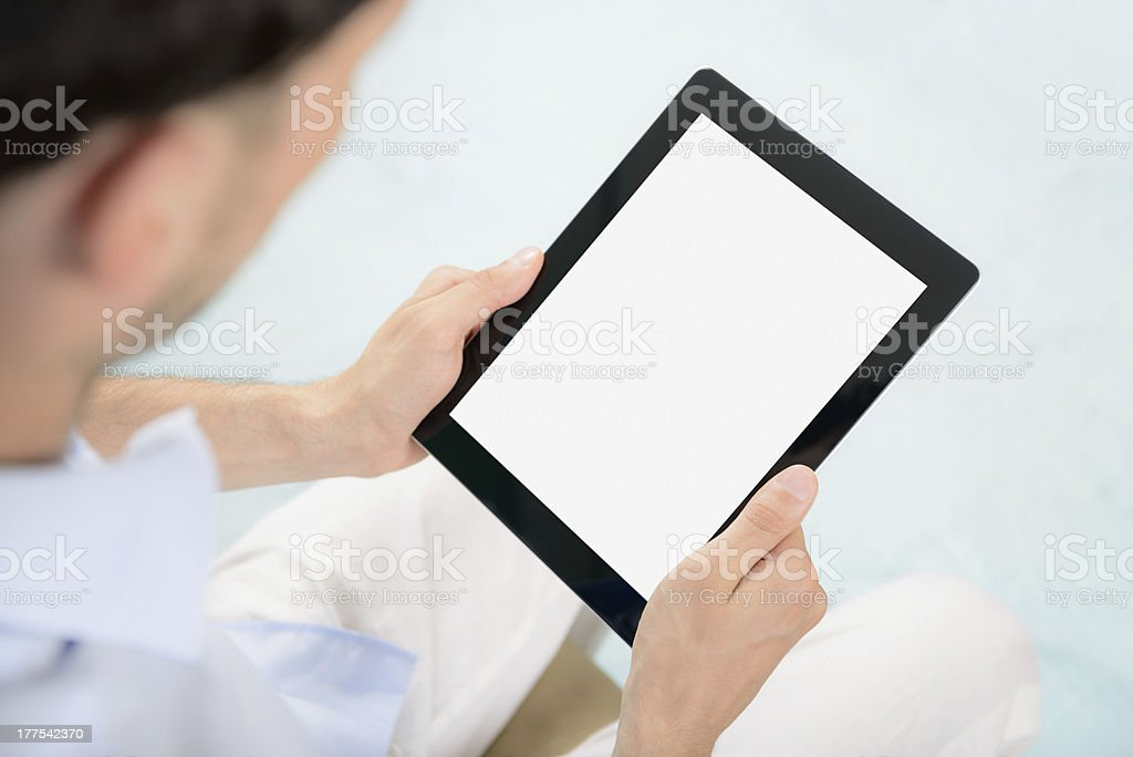 Blank tablet computer in hands royalty-free stock photo