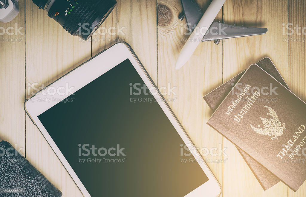 Blank tablet screen with travel equipments. stock photo