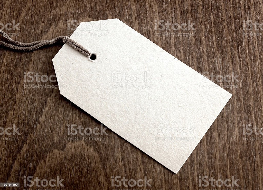 Blank tag on wooden background royalty-free stock photo