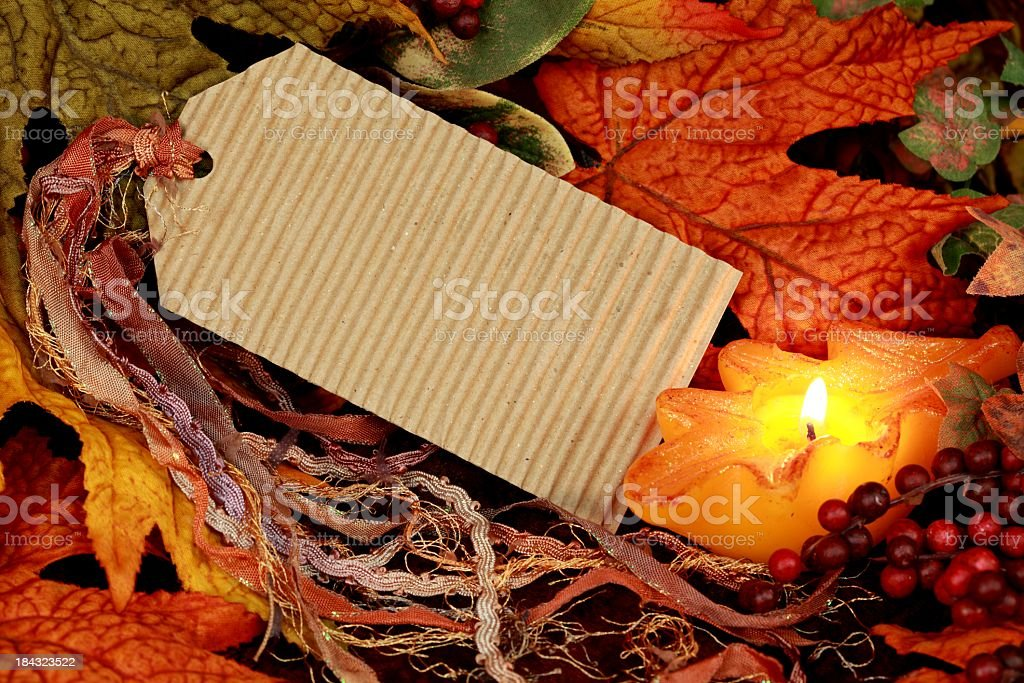 Blank Tag with Autumn Leaves and Candle royalty-free stock photo