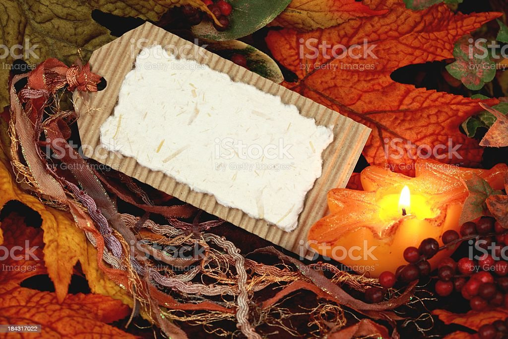 Blank Tag with Autumn Leaves, berries and Candle royalty-free stock photo