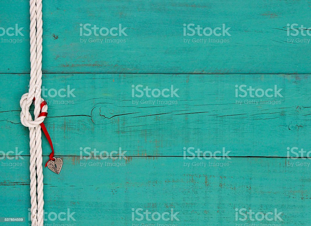 Blank teal blue sign with heart lock hanging from rope stock photo