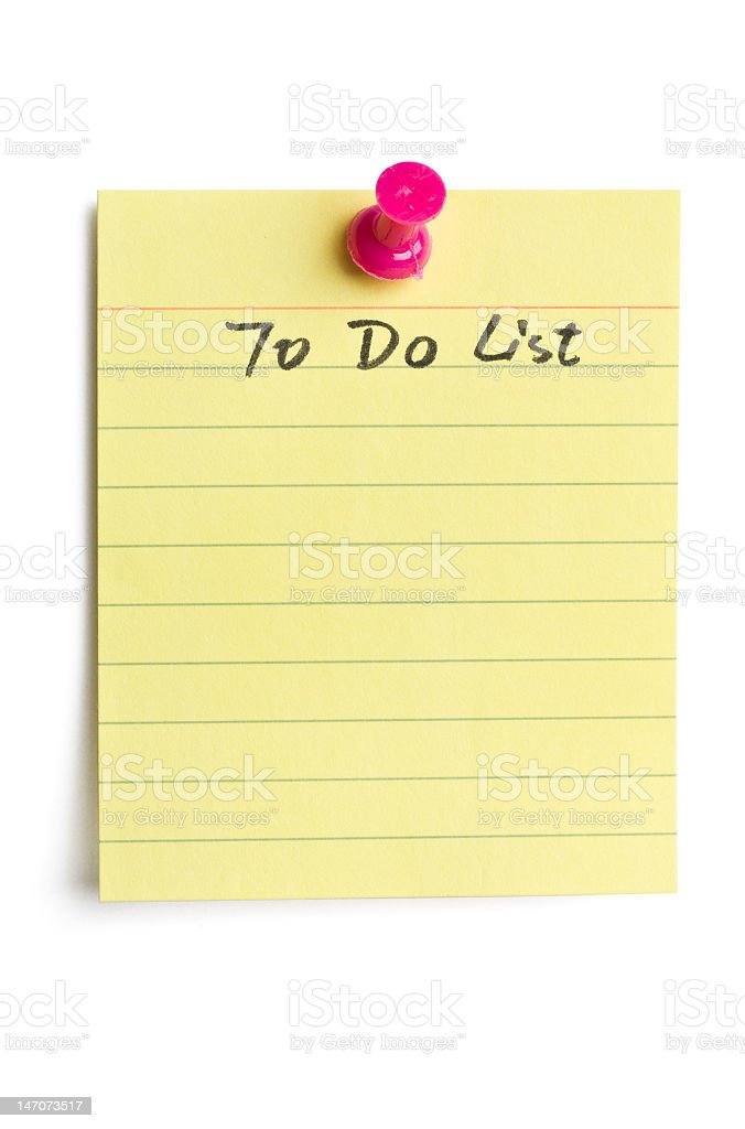A blank To Do list on yellow lined paper isolated on white stock photo
