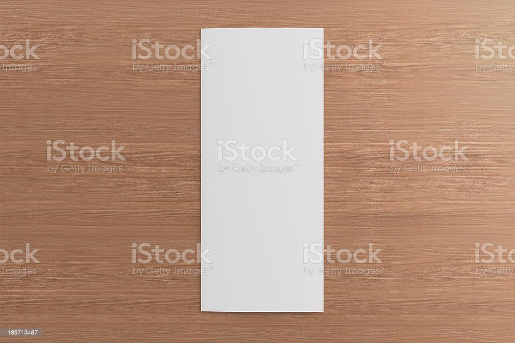 Blank tri fold brochure on wooden background royalty-free stock photo