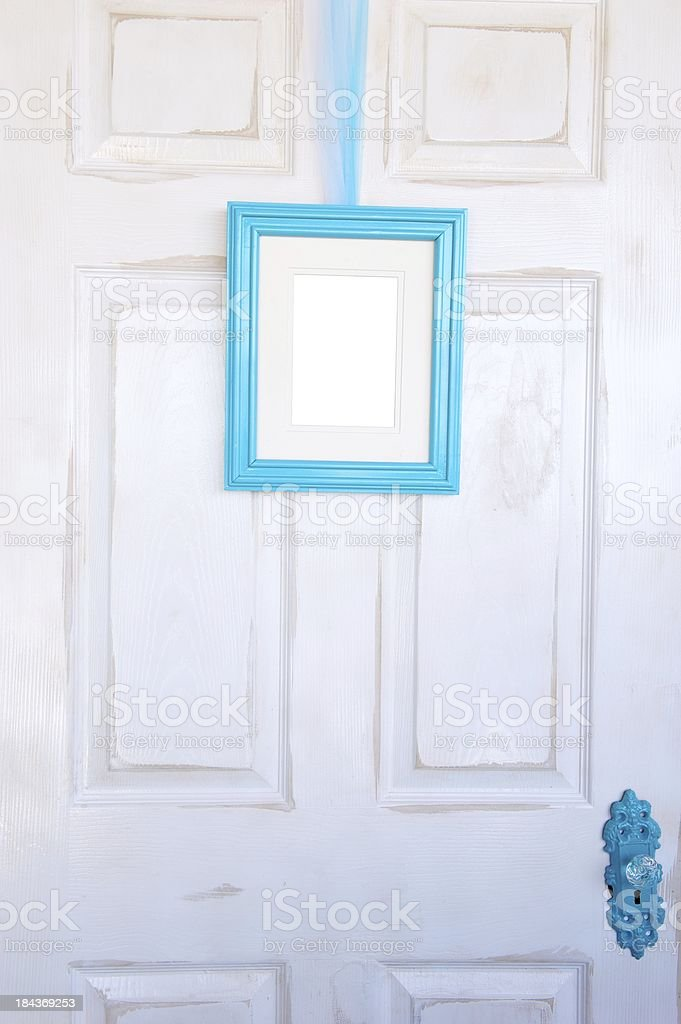 Blank Turquoise Picture Frame on Distressed Door royalty-free stock photo
