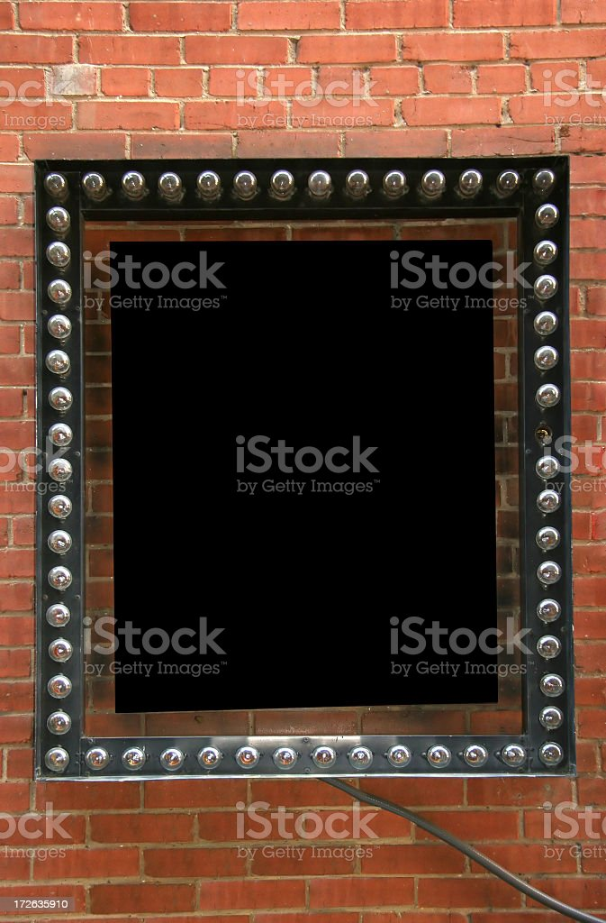 Blank unlit marquee sign on brick wall stock photo