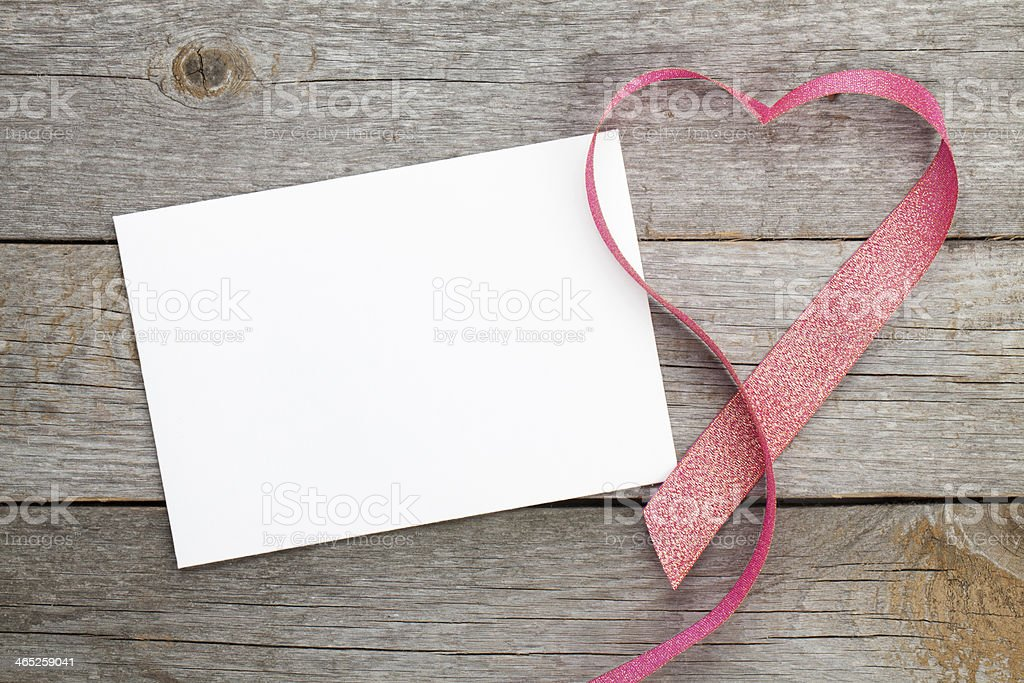 Blank valentines greeting card and red heart shaped ribbon stock photo