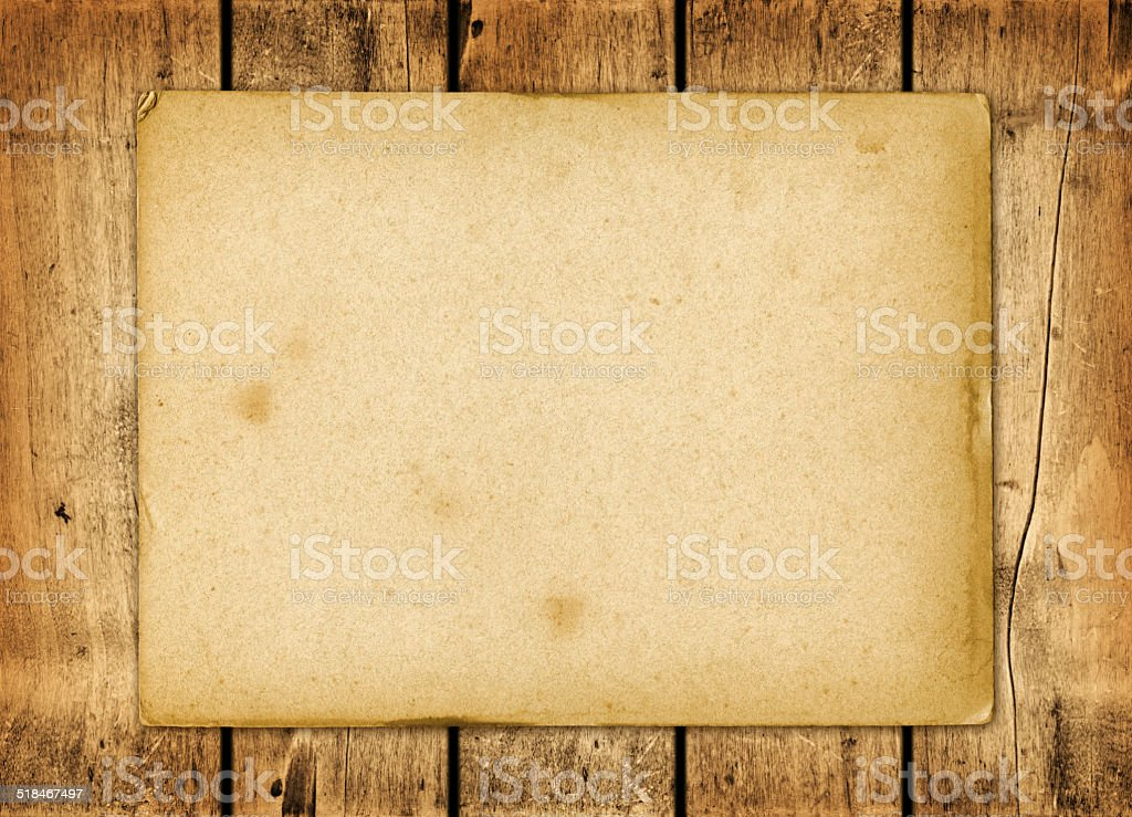 Blank vintage paper sheet on a wood board stock photo