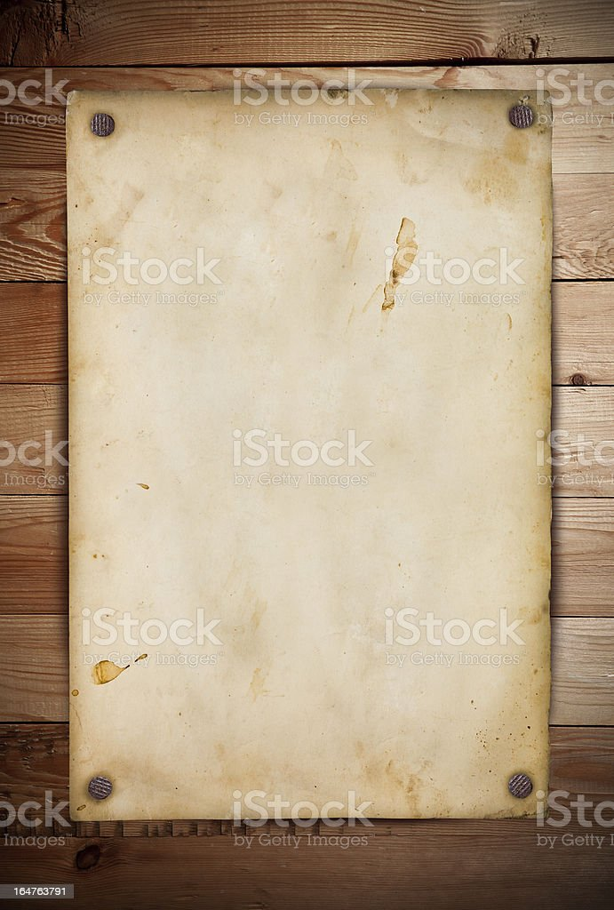 Blank vintage paper tacked onto a wooden wall stock photo
