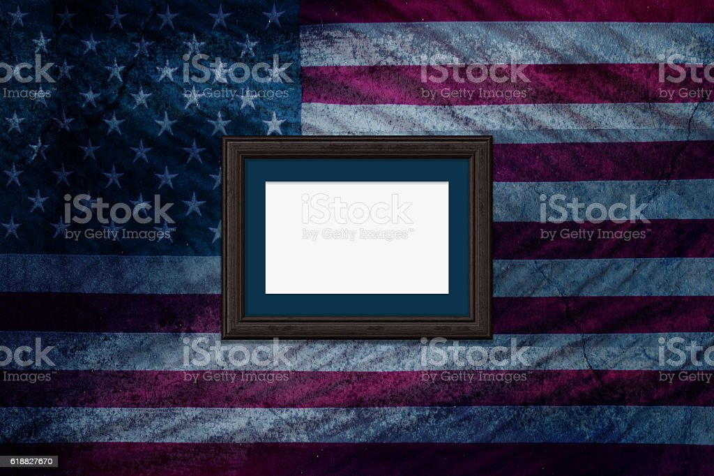 Blank Vintage photo frame on Grunge America Flag wall background stock photo