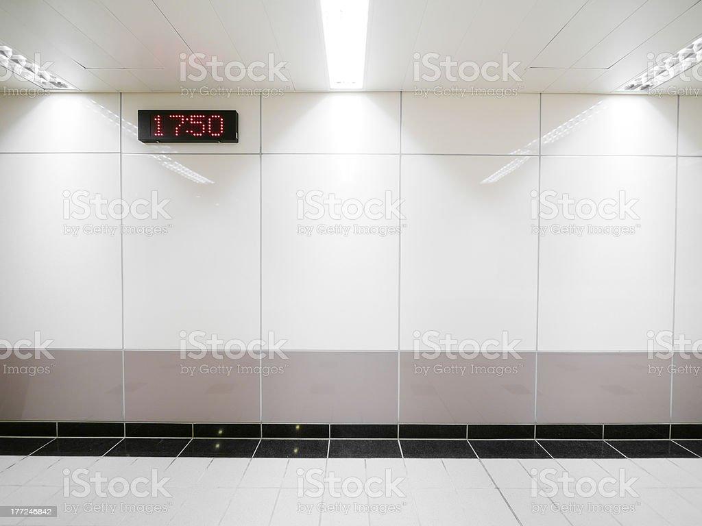 Blank wall and digital clock royalty-free stock photo