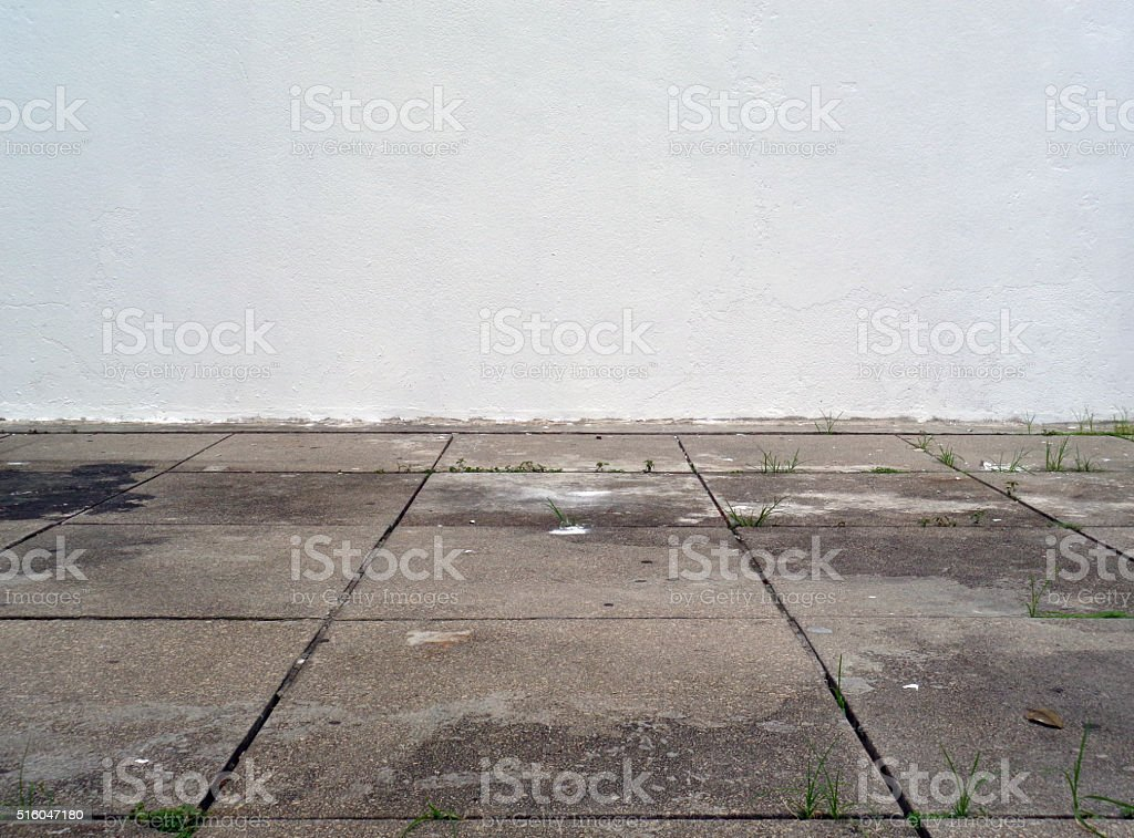 Blank Wall with Damaged Floor stock photo