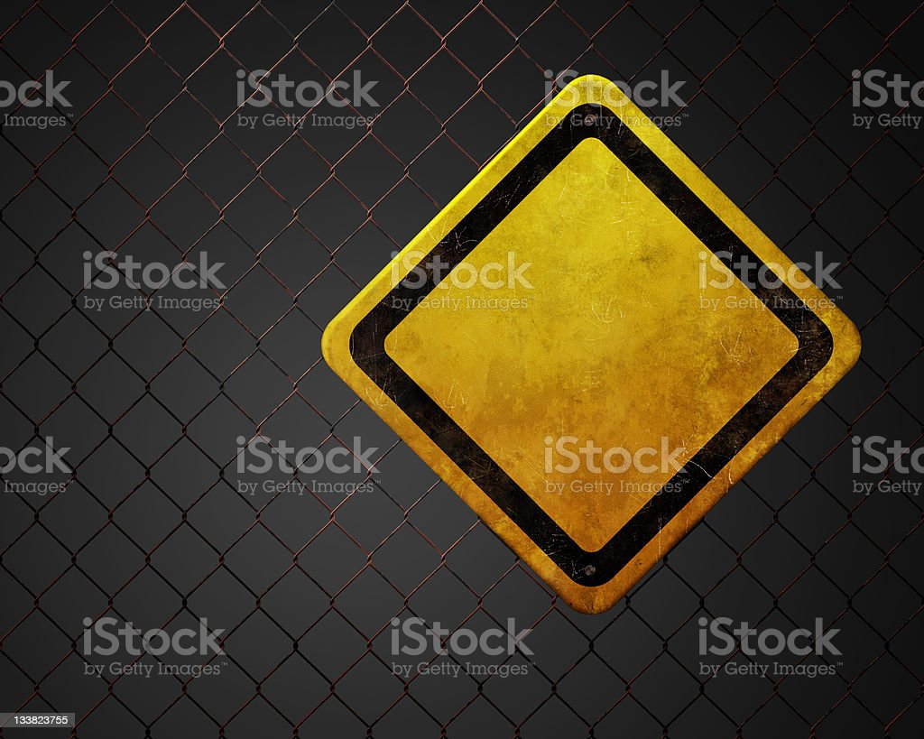 Blank warning sign at chainlink fence royalty-free stock photo