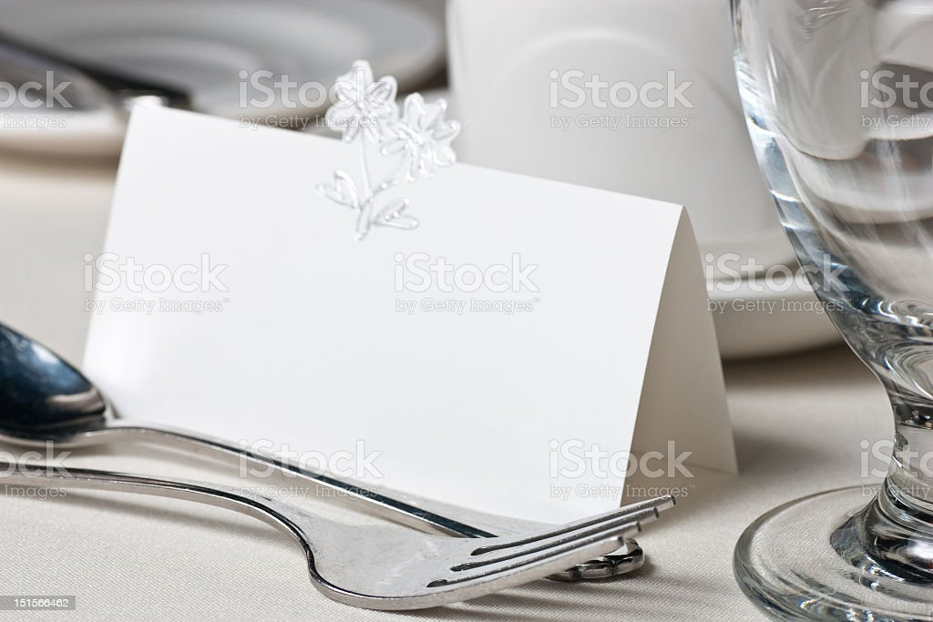 Blank wedding place card in formal table setting stock photo