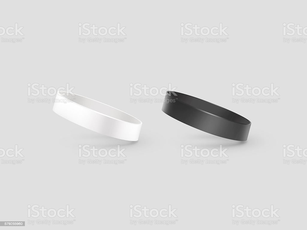 Blank white and black rubber wristband mockup, clipping path, stock photo