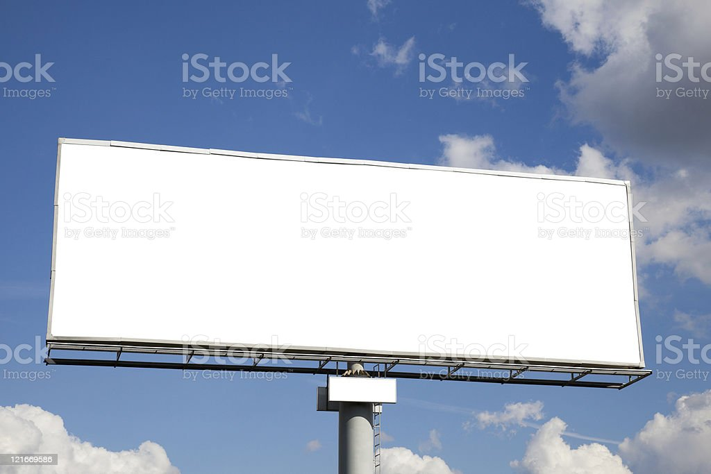 A blank white billboard against a blue cloudy sky royalty-free stock photo