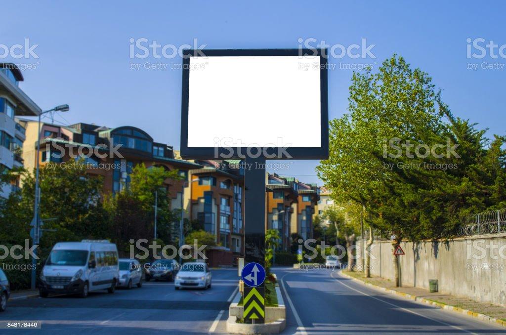 Blank white billboard against the blue sky stock photo