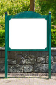 Blank white billboard green signpost in the park.
