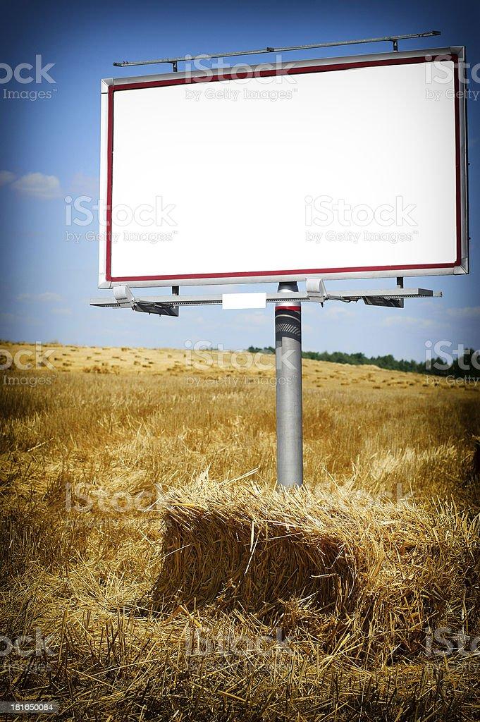 Blank white billboard in a wheat field royalty-free stock photo
