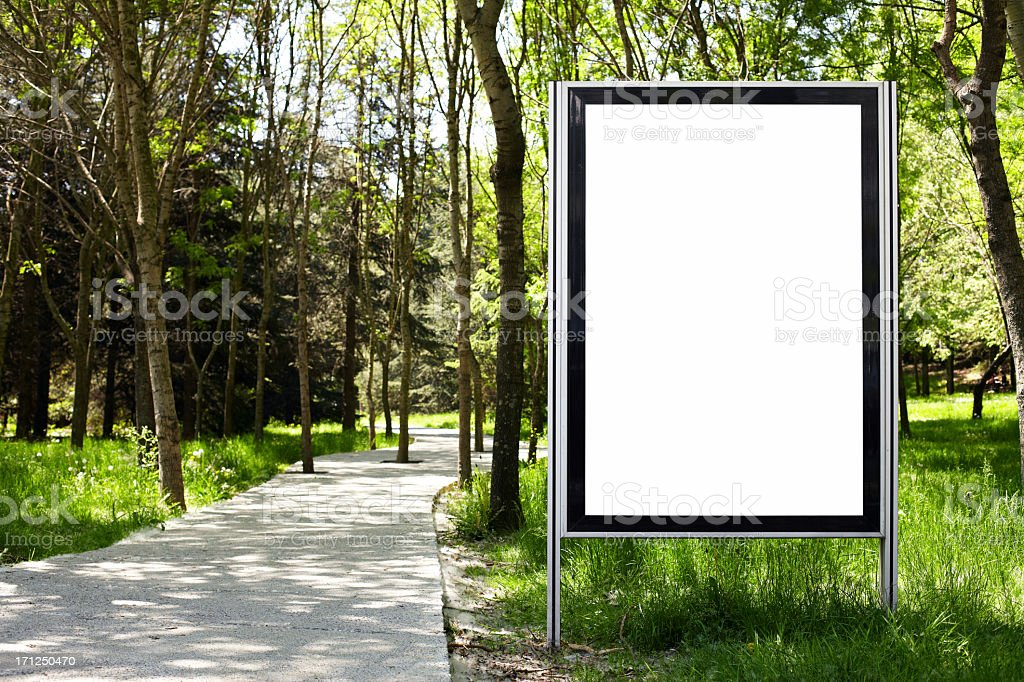 Blank white billboard in the middle of a forest stock photo