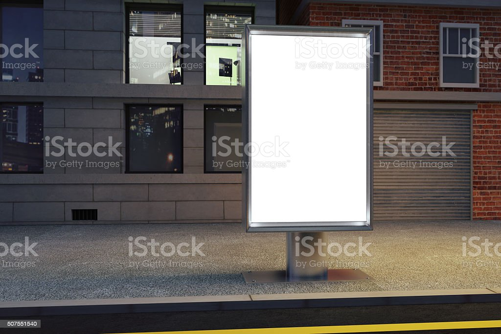 Blank white billboard on the street at night stock photo