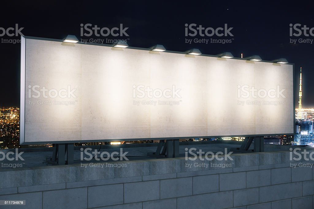 Blank white billboard on the top of building stock photo
