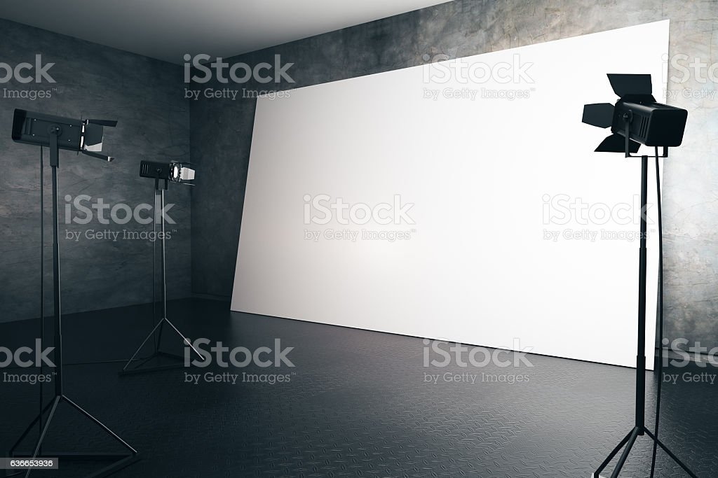 Blank white billboard with professional lighting stock photo