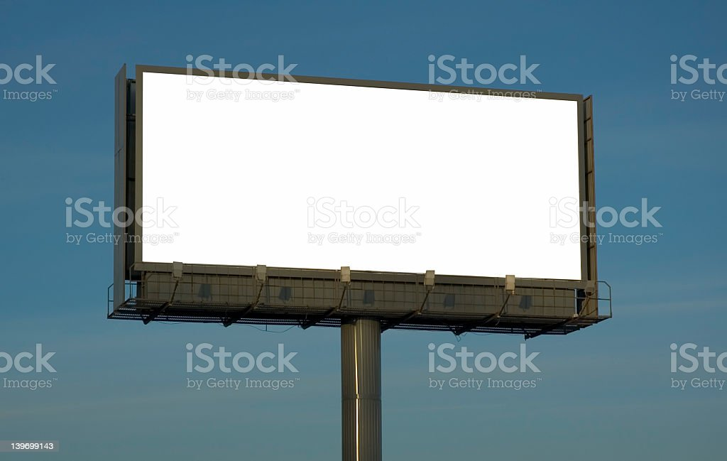 A blank white billboard with the blue sky as background royalty-free stock photo