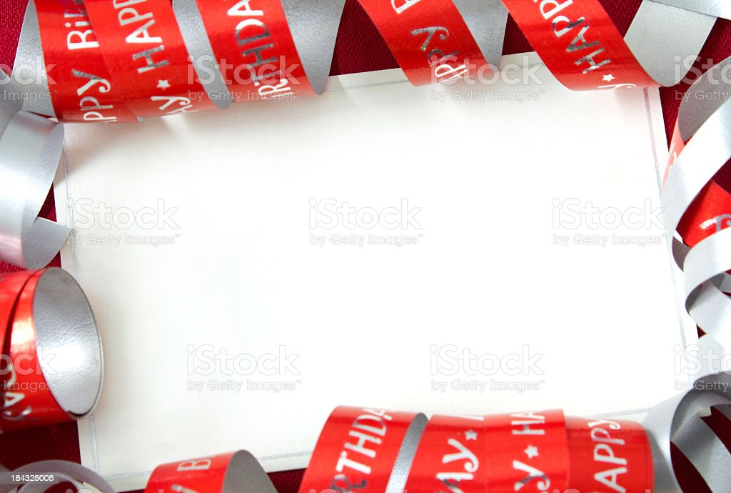 Blank white birthday card with red spiraled border trim stock photo