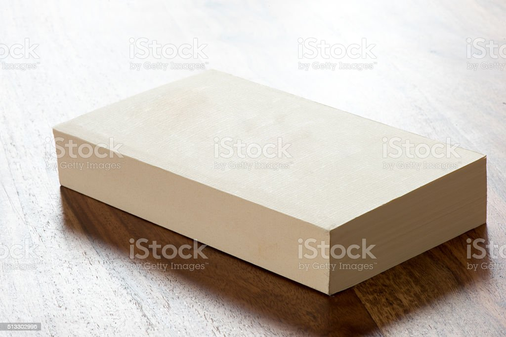 Blank white book on wood texture stock photo