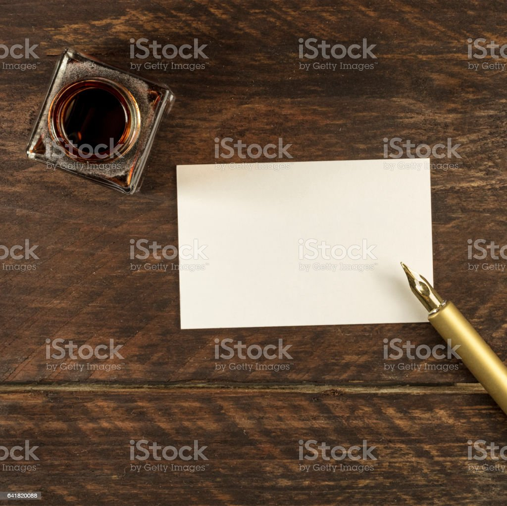 Blank white business card with ink pen and bottle stock photo