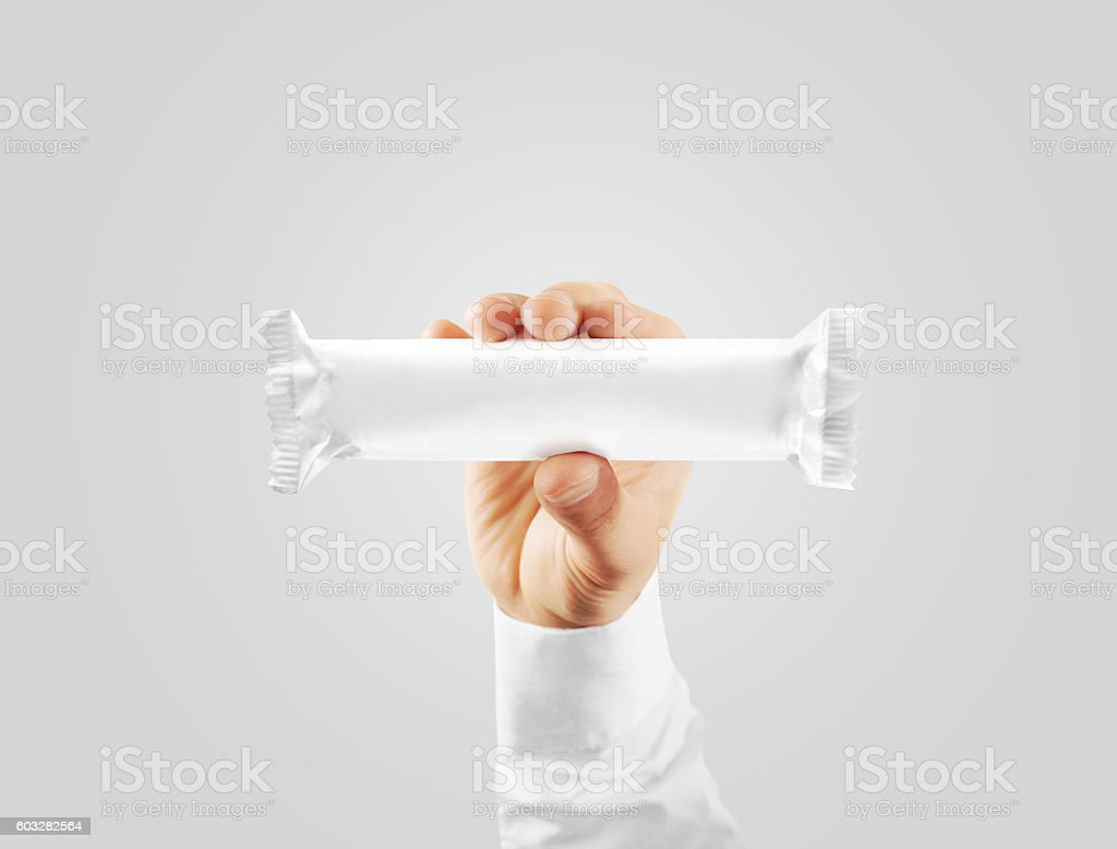 Blank white candy bar plastic wrap mock up holding hand stock photo