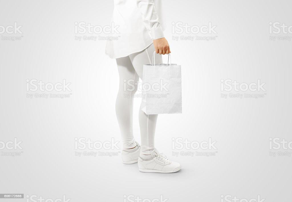 Blank white craft paper bag design mockup holding hand stock photo