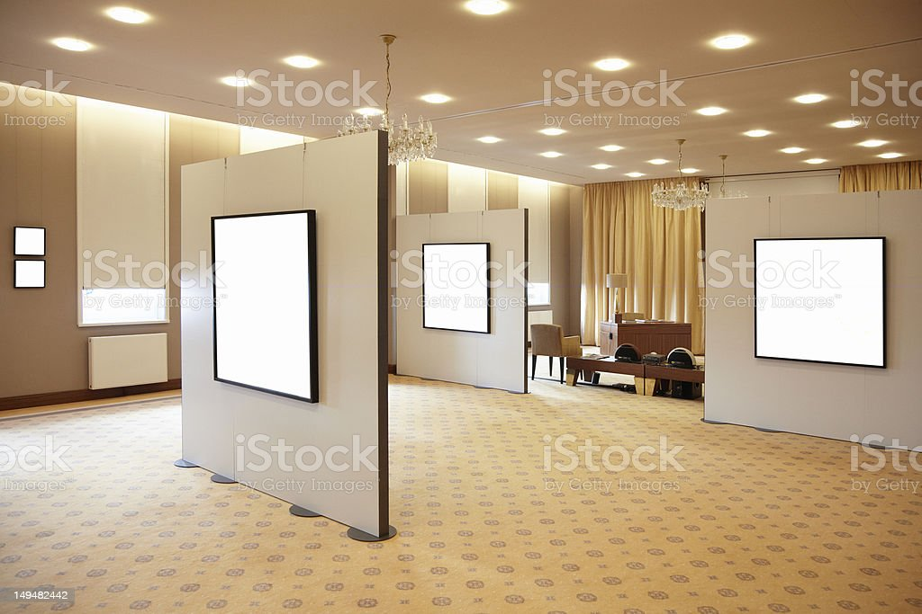 Blank white frames in art gallery interior royalty-free stock photo